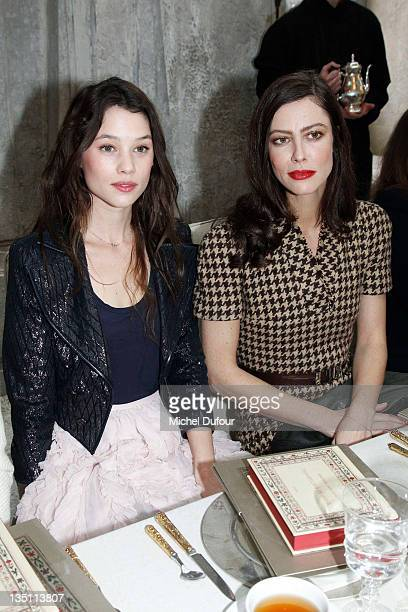Astrid Berges Fisbey and Anna Mouglalis attend the Chanel ParisBombay Show at Grand Palais on December 6 2011 in Paris France