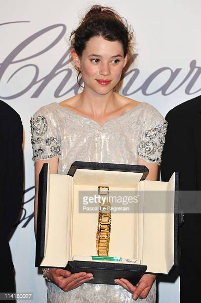 Astrid BergesFrisbey poses with her trophy as she attends the Chopard Trophy Prize Giving Ceremony at the Martinez Hotel during the 64th Cannes Film...