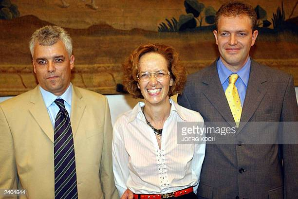 Astrid Bouteuil and her brothers Dyrk Hesshaimer and David Hesshaimer pose 14 August 2003 in Munich Bouteuil and her brothers who claim that they are...