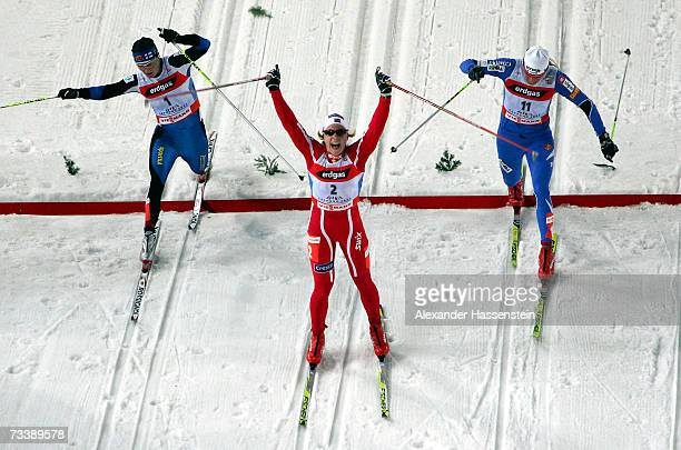 Astrid Jacobsen of Norway celebrates winning the Women 1 km Sprint Classical Event in front of Petra Majdic of Slowenia and Virpi Kuitunen of Finland...
