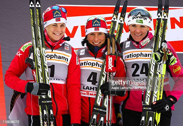 Astrid Jacobsen of Norway Marit Bjoergen of Norway and Petra Majdic of Slovenia pose on the podium after the women's individual sprint of the FIS...
