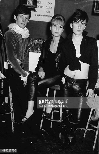Astrid Kirchherr with Stuart Sutcliffe and Klaus Voormann at a party at the LiLaLe in Hamburg Germany circa 1961