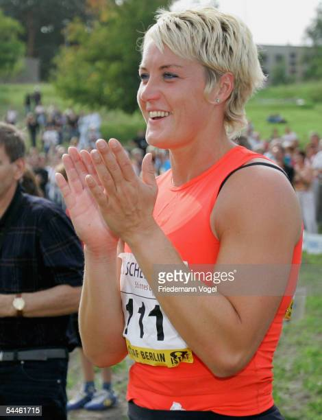 Astrid Kumbernuss of Germany applauds during the shot put retiring competititon of Astrid Kumbernuss on September 03, 2005 in Berlin, Germany. This...