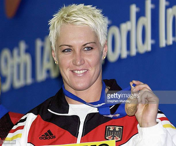Astrid Kumbernuss of Germany celebrates with her bronze medal in yesterdays Womens Shot Putt Final during the 9th IAAF World Indoor Athletics...