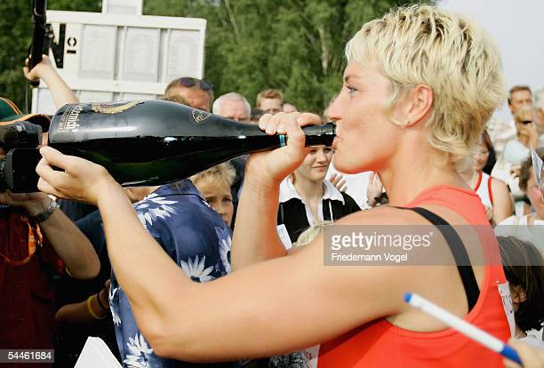 Astrid Kumbernuss of Germany drinks from a bottle during the shot put retiring competititon of Astrid Kumbernuss on September 03 2005 in Berlin...