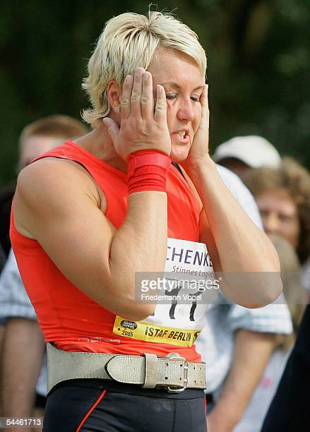 Astrid Kumbernuss of Germany holds her head during the shot put retiring competititon of Astrid Kumbernuss on September 03, 2005 in Berlin, Germany....
