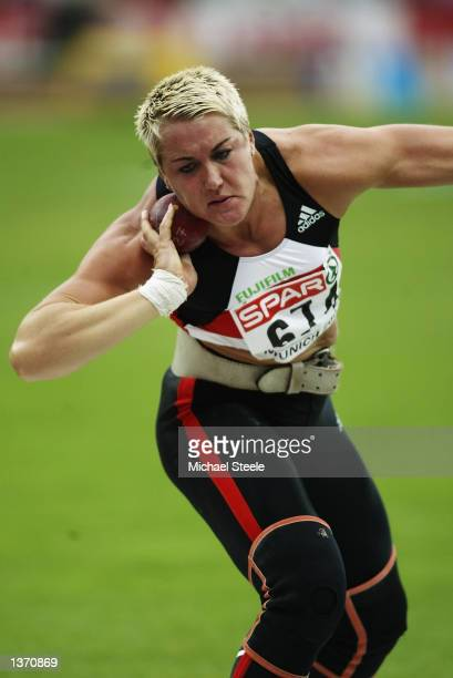 Astrid Kumbernuss of Germany in action during the shot put finals at the 18th European Championships in Athletics at the Olympic Stadium in Munich...