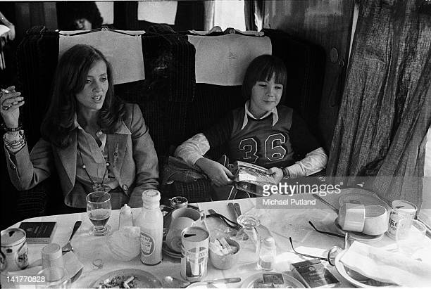 Astrid Lundstrom then partner of Bill Wyman of the Rolling Stones with her son en route from Manchester by train during the 1973 UK tour