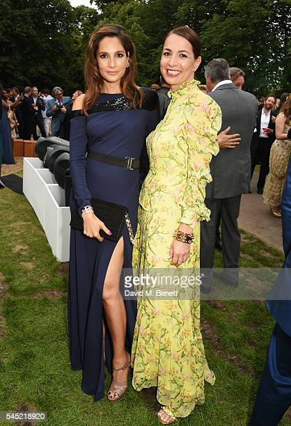 Astrid Munoz and Yana Peel attend The Serpentine Summer Party cohosted by Tommy Hilfiger on July 6 2016 in London England