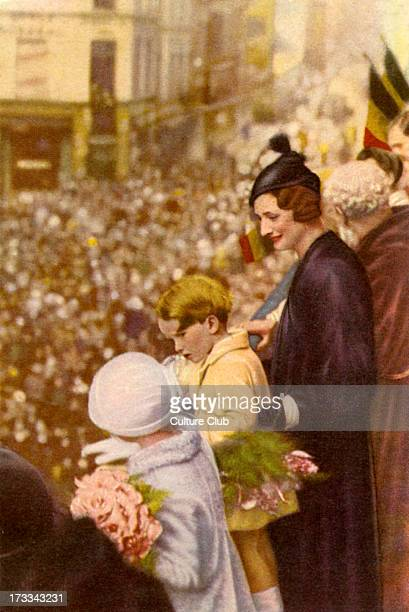 Astrid of Sweden with her children Princess JoshéphineCharlotte and Prince Baudouin watching a children's parade from the Rue Haute Brussels Belgium...