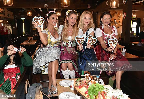 Astrid Soell and Gitta Saxx, Giulia Siegel, Sonja Kiefer and Simone Ballack attend the Charity Lunch at 'Zur Bratwurst' during the Oktoberfest 2016...
