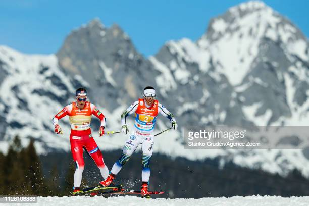 Astrid Uhrenhold Jacobsen takes 2nd place Charlotte Kalla of Sweden takes 1st place during the FIS Nordic World Ski Championships Women's Cross...