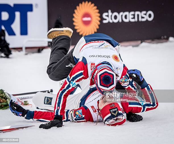 Astrid Uhrenholdt Jacobsen and Heidi Wang of Norway celebrates a gold medal during the Ladies 4 x 5.0 km Relay Classic/Free during the FIS Nordic...