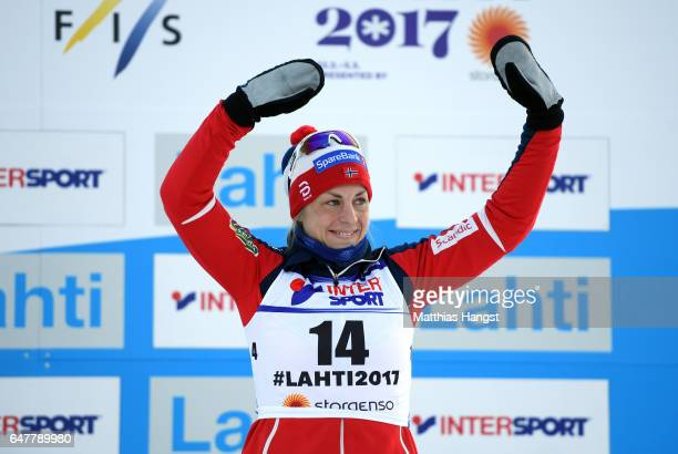 Astrid Uhrenholdt Jacobsen of Norway celebrates her third place in the Women's Cross Country Mass Start during the FIS Nordic World Ski Championships...