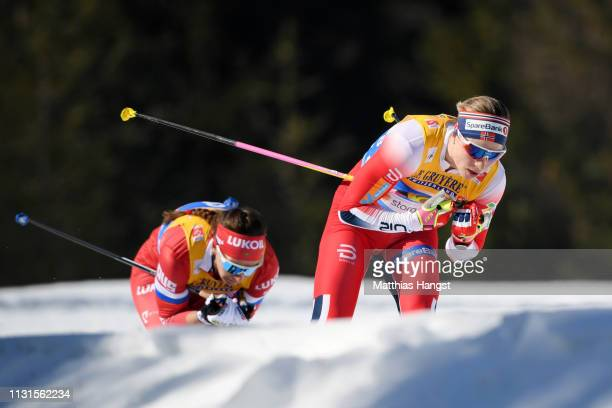 Astrid Uhrenholdt Jacobsen of Norway competes in the Cross Country Skiathlon Ladies 15k race during FIS Nordic World Ski Championships on February 23...
