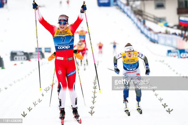 Astrid Uhrenholdt Jacobsen of Norway takes 1st place, Ebba Andersson takes 2nd place during the FIS Nordic World Cup Men's and Women's Cross Country...