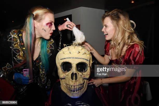 Astrid Victoria Jordan Guisnel from Voltage Radio and Julie Jardon in skeletton suit and Julie Jardon attend the Bal des Vampires 2017 at Pavillon...