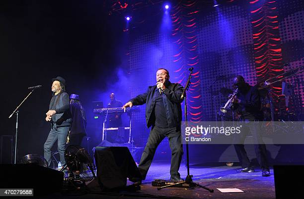 Astro and Ali Campbell of UB40 perform on stage at Brixton Academy on April 18 2015 in London United Kingdom
