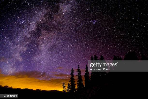 astro landscape with stars and milky way galaxy - rocky mountains north america stock pictures, royalty-free photos & images
