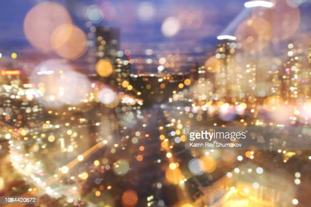 astro projection. dazzling data stream of cityscape dimensions - verlicht stockfoto's en -beelden