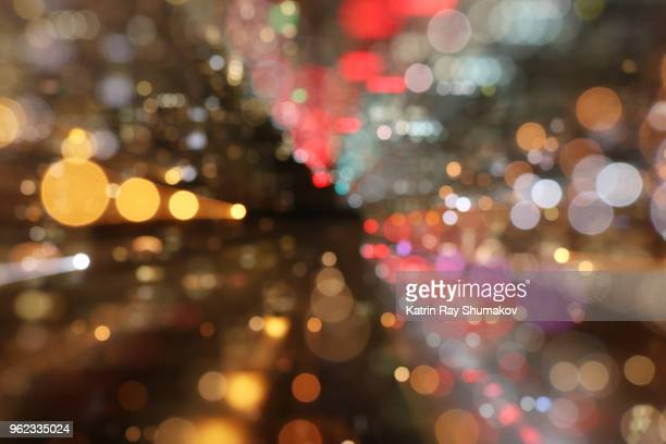 astro projection. dazzling dimensions of night city - lighting technique stock pictures, royalty-free photos & images