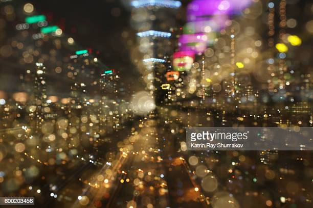 Astro Projection. Golden Cityscapes in Sparkling Bokeh Dimensions