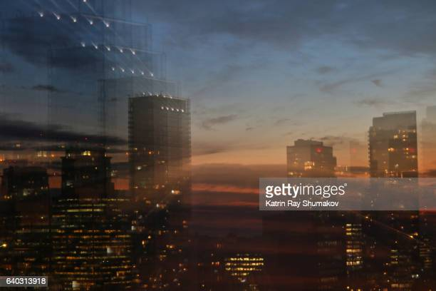 astro projection. multiple sunset dimensions in the sparkling city - zoom in stock pictures, royalty-free photos & images