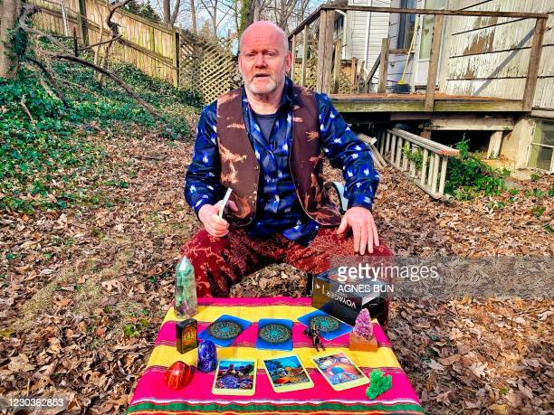 Astrologer Randy Goldberg reads tarot cards for 2021 on December 30 as he is interviewed in the backyard of his home in Arlington, Virginia. - US...