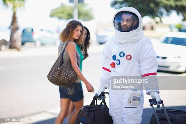 astronaut after work - schutzanzug stock-fotos und bilder