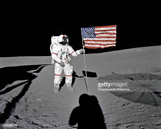 Astronaut Alan B Shepard Jr Astronaut Alan B Shepard Jr Apollo 14 Commander Stands By The US Flag On Lunar Fra Mauro Highlands During The Early...
