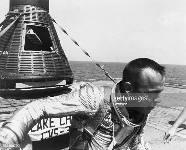 Astronaut Alan Shepard and the Freedom 7 space capsule sit on the deck of the USS Champlain aircraft carrier after the completion of the Mercury 3...