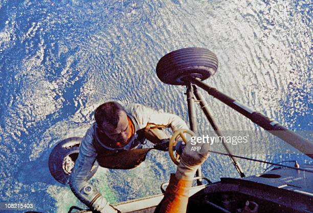 US astronaut Alan Shepard is lifted up to the helicopter after he splashed down in the Atlantic Ocean aboard the Mercury capsule on May 5 1961 Alan...