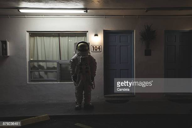 Astronaut alone at a motel
