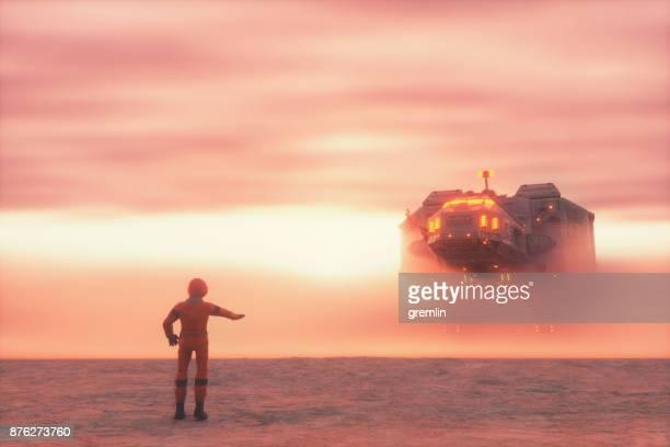 Astronaut and alien spaceship in fog