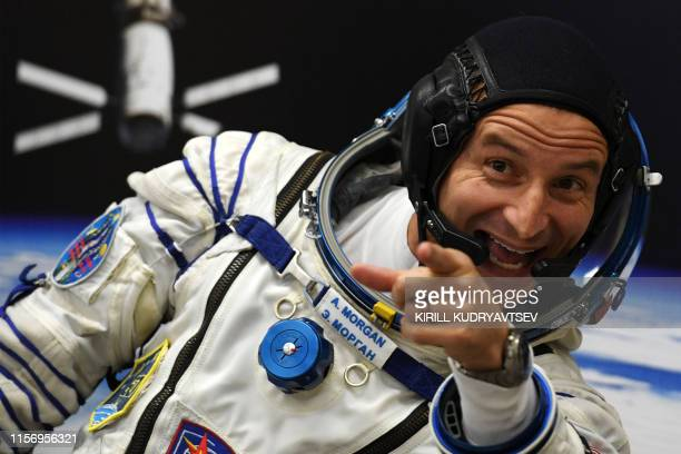 NASA astronaut Andrew Morgan a member of the International Space Station expedition 60/61 reacts as his spacesuit is tested prior to the launch...