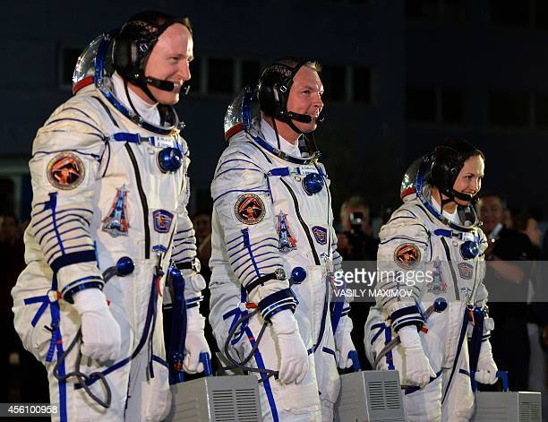 US astronaut Barry Wilmore Russia's cosmonauts Alexander Samokutyayev and Yelena Serova Alexander Samokutyayev before the launch of the the Soyuz...