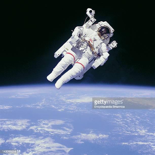 Astronaut Bruce Mccandless Ii In Space Astronaut Bruce Mccandless Floating In Space On The First Untethered Spacewalk Feb 1984