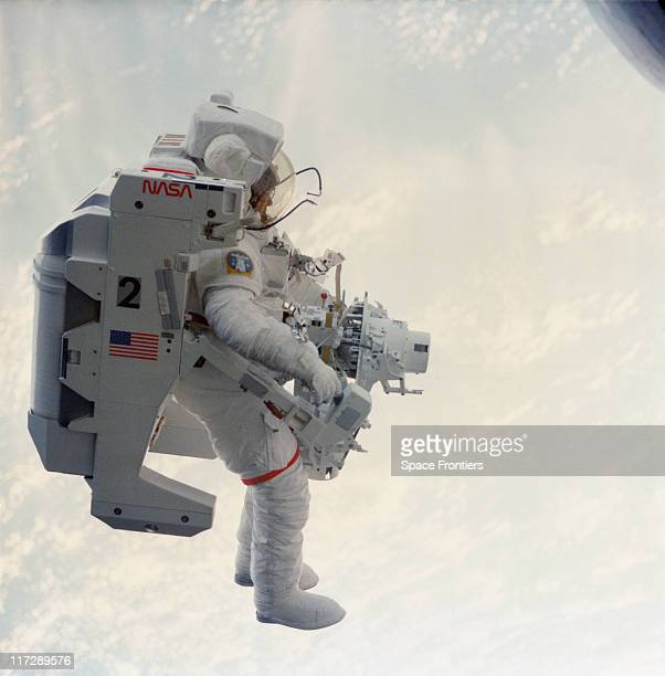 NASA astronaut Bruce McCandless II performs EVA with a Manned Maneuvering Unit during the STS41B mission February 1984
