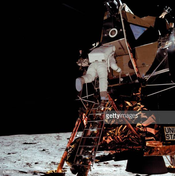 US astronaut Buzz Aldrin climbs down the ladder from the lunar module Eagle 15 minutes after Neil Armstrong on July 21 1969 The two astronauts of the...