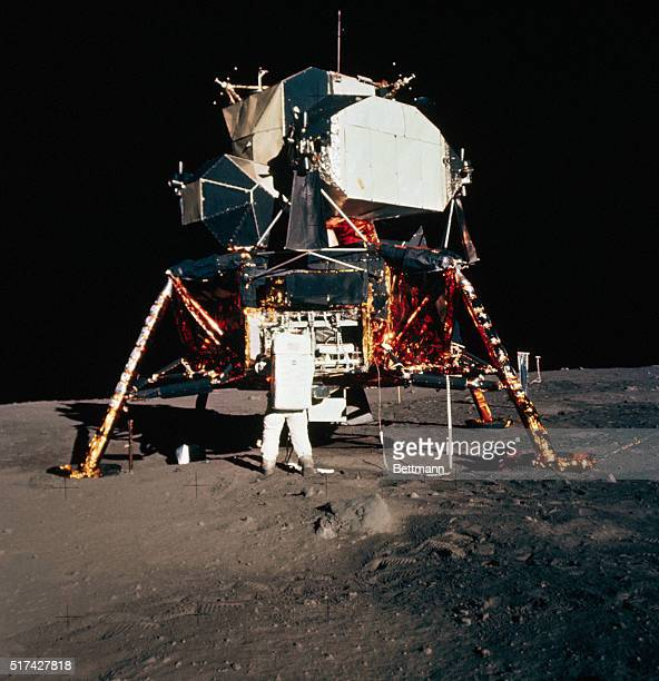 Astronaut Buzz Aldrin prepares to deploy the Early Apollo Scientific Experiments Package from the Eagle lunar module during lunar surface extra...