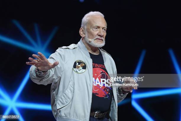 Astronaut Buzz Aldrin speaks on stage during WE Day New York Welcome to celebrate young people changing the world at Radio City Music Hall on April 6...
