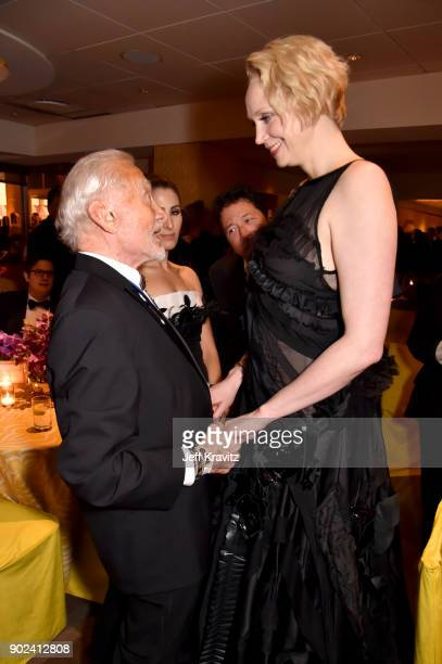 Astronaut Buzz Aldrin speaks with actor Gwendoline Christie of 'Game of Thrones' attends HBO's Official 2018 Golden Globe Awards After Party on...