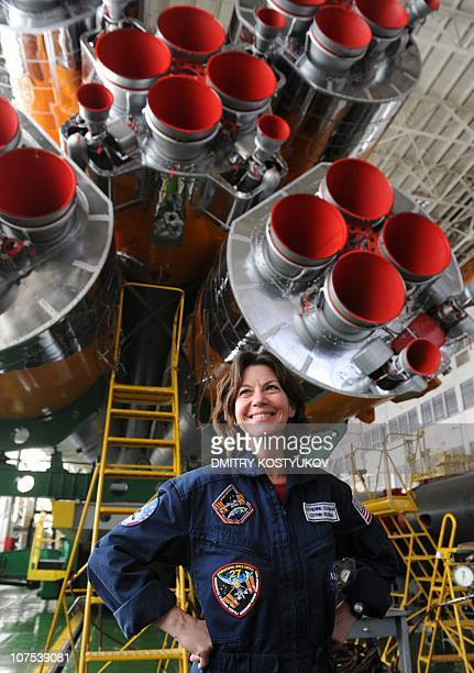 US astronaut Cady Coleman poses for photographers near the Russian Soyuz TMA20 at the Russian leased Baikonur cosmodrome on December 11 2010 Soyuz...