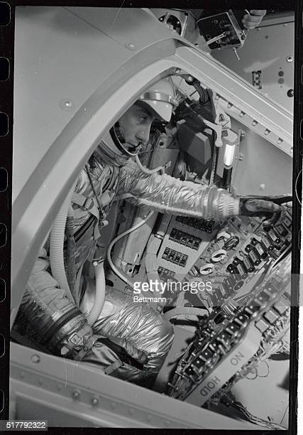 Astronaut Capt Virgil Grissom of the US Air Force tucked in a mock space capsule makes a simulated space flight at the national aeronautics and space...