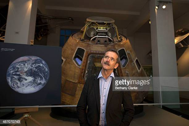 Astronaut Chris Hadfield poses for photos in front of the Apollo 10 Command Module which travelled around the Moon in 1969 on December 16 2013 in...
