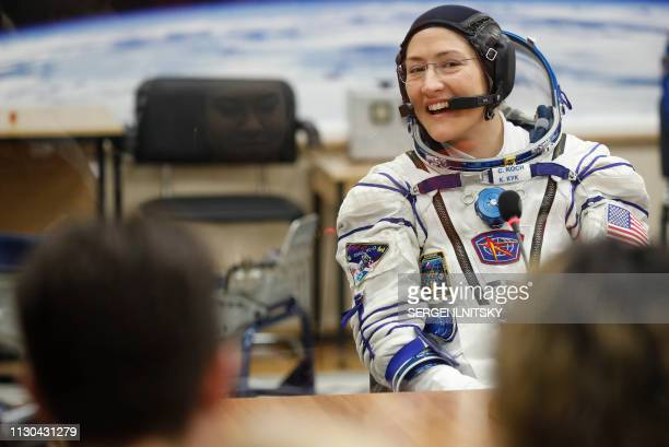 NASA astronaut Christina Hammock Koch a member of the International Space Station expedition 59/60 reacts as her spacesuit is tested prior to the...