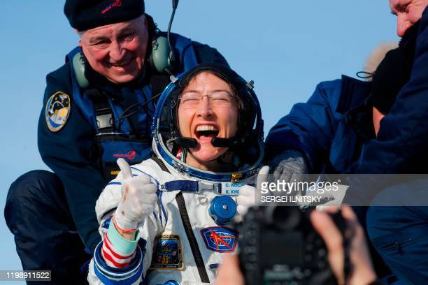 TOPSHOT NASA astronaut Christina Koch reacts shortly after landing in a remote area outside the town of Dzhezkazgan Kazakhstan on February 6 2020...