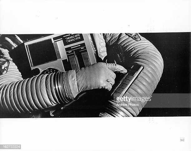 Astronaut controlling mechanisms of his suit in a scene from the film '2001 A Space Odyssey' 1968