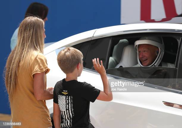 Astronaut Doug Hurley say goodbye to his wife Karen Nyberg and son Jack after walking out of the Operations and Checkout Building on their way to the...