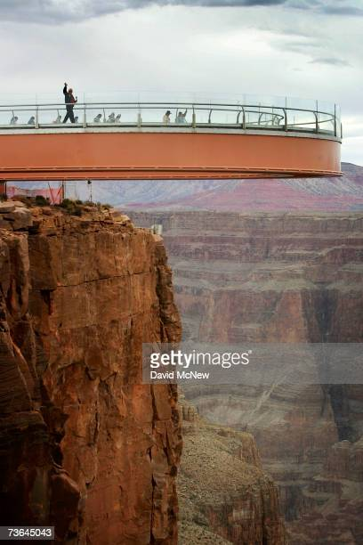 Astronaut Dr. Buzz Aldrin, who walked on the moon on July 20 waves as he and members of the Hualapai tribe take the first walk on the Skywalk, billed...